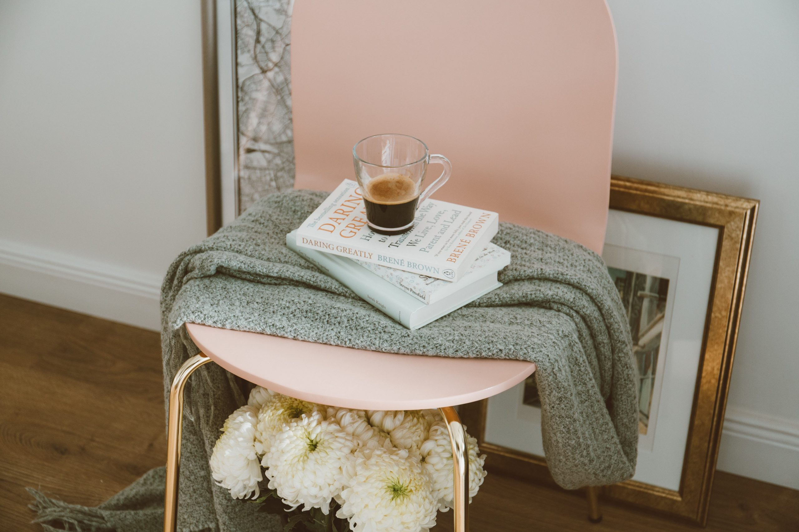 photo of a coffee cup on books on a blanket on a chair representing self care. Something that therapists are bad at. Meet with online therapist melissa russiano who offers therapy for therapists in ohio, therapy for therapists in pennsylvania, therapy for therapist in tennessee, therapy for therapists in florida, and therapy for therapists in California to treat therapist burnout