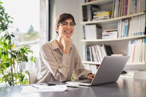 happy professional woman goes to online therapy in pennsylvania with melissa russiano who provides online counseling for stress, anxiety, burnout and compassion fatigue therapy in pennsylvania