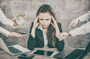 Overwhelmed female working professional that has lots of hands asking her to do things. She gets online therapy for imposter syndrome with melissa russiano who offers online therapy in florida, online therapy in tennessee, online therapy in pennsylvania, and online therapy in ohio.