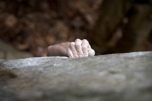 photo of a hand holding onto a rock representing burnout. Get online therapy for helping professionals with melissa russiano who offers therapy for therapists, online therapy in florida, online therapy in california, online therapy in pennsylvania, online therapy in ohio, online therapy in tennessee